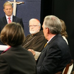 Cardinal Sean O'Malley and John Garvey (with back to camera) participate in religious freedom discussion in Boston.