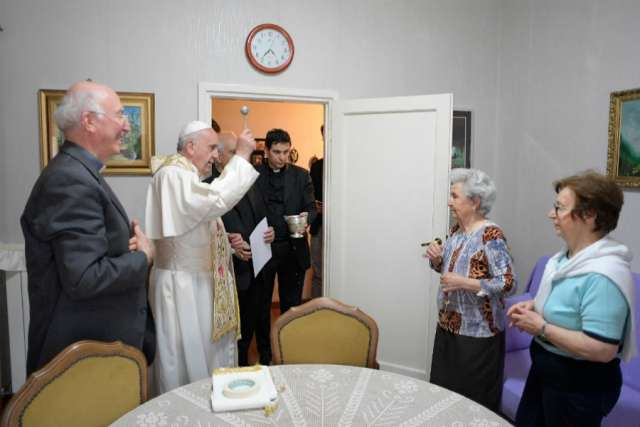 Pope Francis blesses a home in Ostia, Italy, May 19.