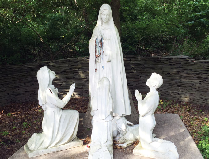 Above, the Asbury, New Jersey, shrine highlights Marian devotion in a serene setting, including a statue scene of the seers and Our Lady. Below, the Holliston, Massachusetts, shrine celebrates the Blessed Mother among nature's beauty.