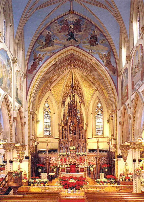 In this photograph of the sanctuary of St. John's in Orange, NJ, you can see both of the images I refer to in my homily: the painting of Christ glorified in heaven over the arch (the subject is the coronation of the Blessed Virgin) and the large crucifixion scene behind the ambo. (In my homily I say the crucifixion is on my right. That's because this is an older photograph; the ambo has been moved and the stairs retired. Other than that and some water damage to the ceiling, the church looks pretty much the same.)
