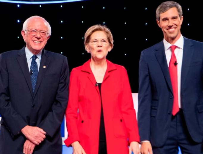 U.S. Sen. Bernie Sanders, I-Vt., U.S. Sen. Elizabeth Warren, D-Mass., and former U.S. Rep. Beto O'Rourke from Texas, shown arriving for the first round of the second Democratic primary debate of the 2020 presidential campaign season hosted by CNN at the Fox Theatre in Detroit on July 30, support repealing the Helms Amendment, a long-standing ban on the use of U.S. taxpayer funds for abortion overseas.