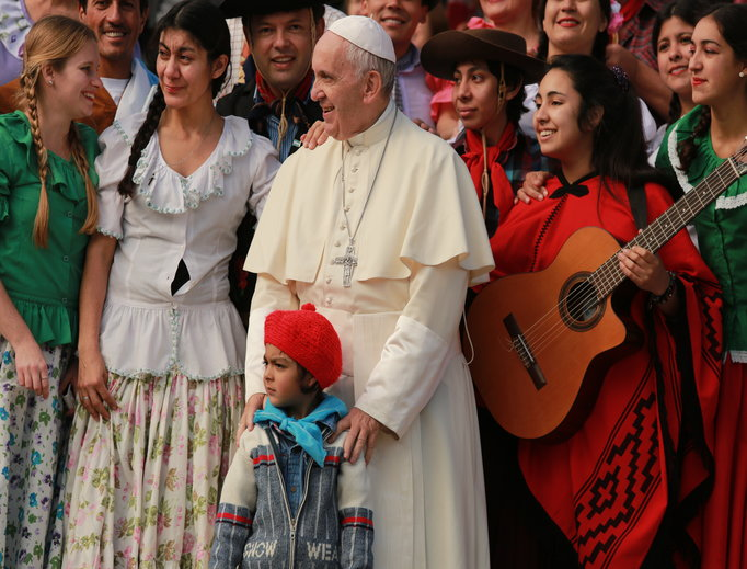 Pope Francis greets pilgrims at the general audience in St. Peter's Square on Oct. 19.