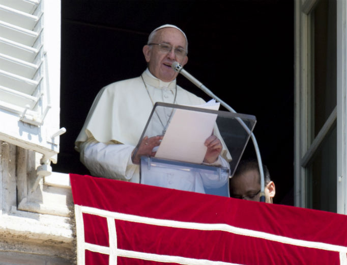 Pope Francis leads the Angelus Sept. 1 from the window of the apostolic palace overlooking St. Peter's Square.