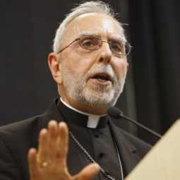 In this file photo, Bishop Gerald F. Kicanas of Tucson, Ariz., addresses the audience after receiving the Cardinal Joseph Bernardin Award from the Catholic Common Ground Initiative June 27, 2008, at The Catholic University of America in Washington.