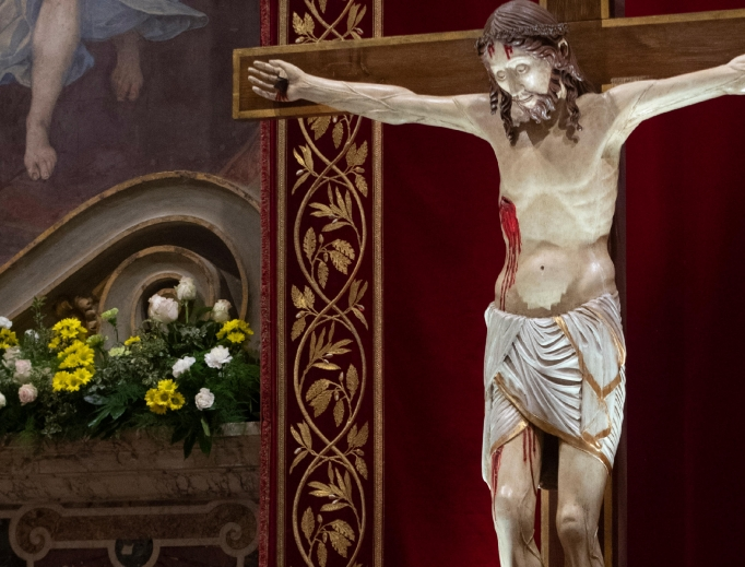A crucifix is in view at a penitential service with Pope Francis on the fourth and final day of the meeting on 'The Protection of Minors in the Church' at the Vatican Feb. 24.