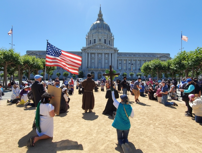 Catholic priests and the faithful gather in prayerful protest in front of San Francisco's City Hall July 5.