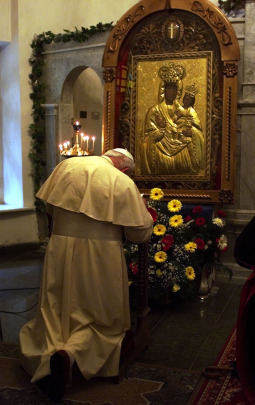 Pope John Paul II prays before an image of Our Lady of Zarvaniza at the Church of St. Nicholas in Kiev at the start of his five-day trip to Ukraine in 2001.