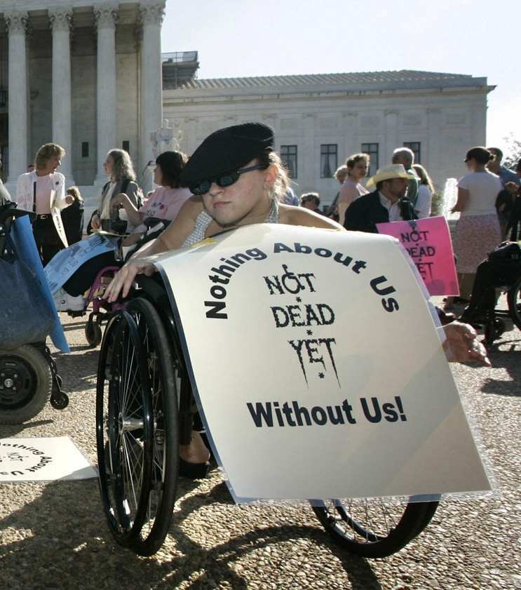 Disabled person protests against assisted suicide.