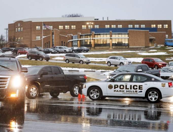 Students arrive Jan. 23 at Covington Catholic High School in Park Hills, Kentucky, as classes resume following a closing due to security concerns the previous day. Local police authorities controlled access to the property at entrances and exits.