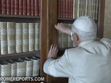 Benedict XVI locking a bookcase in the library at Castel Gandolfo in 2010.