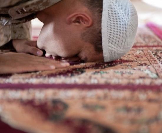 Muslim chaplain prays during the Islamic holy month of Ramadan.