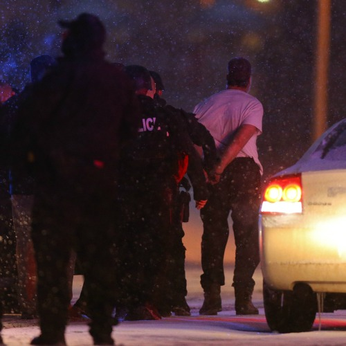 Suspect Robert Dear is led away in handcuffs by police following a deadly mass shooting Nov. 27 outside a Planned Parenthood facility in Colorado Springs, Colo. The alleged killer has no known connection with local pro-life advocates.