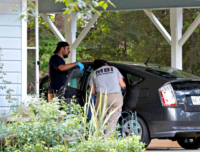 Two Mississippi Bureau of Investigation agents inspect a car in the garage of the Durant, Miss., home of two slain Catholic nuns who worked as nurses at the Lexington Medical Clinic, Aug. 25. The clinic office manager and a Durant police officer discovered their bodies inside the house after both nuns did not report for work. Authorities said their were signs of a break-in and their vehicle was missing.