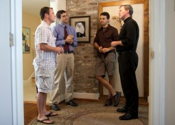HOLY HOUSE. Father Jeffrey Kirby, vicar of vocations for the Charleston, S.C., Diocese, encourages young men like (left to right) Seth Toft, Rhett Williams and Christopher Davies to discern God's call for their lives as they live in community in Drexel House.
