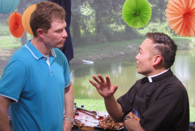 Former altar boy Bobby Flay issues his fajita throwdown challenge to Father Leo Patalinghug on the Food Network.