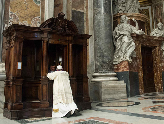 Pope Francis goes to confession at St. Peter's Basilica on March 28, 2014.