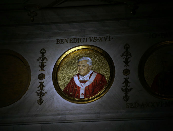 The icon of Pope Benedict XVI is lit inside the Basilica of St. Paul Outside the Walls in Rome, Feb. 11, 2013. Pope Benedict XVI that day announced he would become the first pontiff in 600 years to resign.