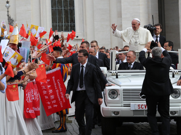Pope Francis waves at pilgrims from China at his general audience in St. Peter's Square on Sept. 7, 2016.