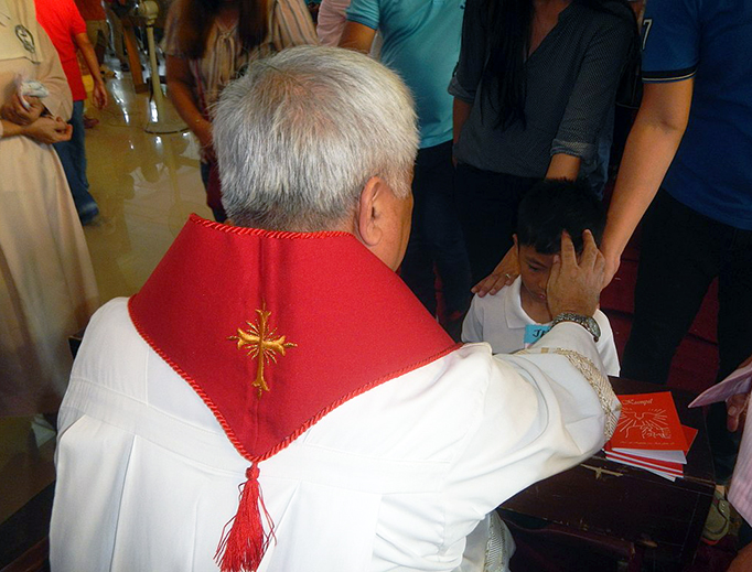 Confirmation in the Santo Cristo and Saint Andrew Kim Taegon Parish Church in the Philippines