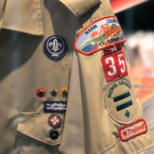 A Boy Scout uniform hangs in a store at the Marin Council of the Boy Scouts of America on July 27 in San Rafael, Calif.
