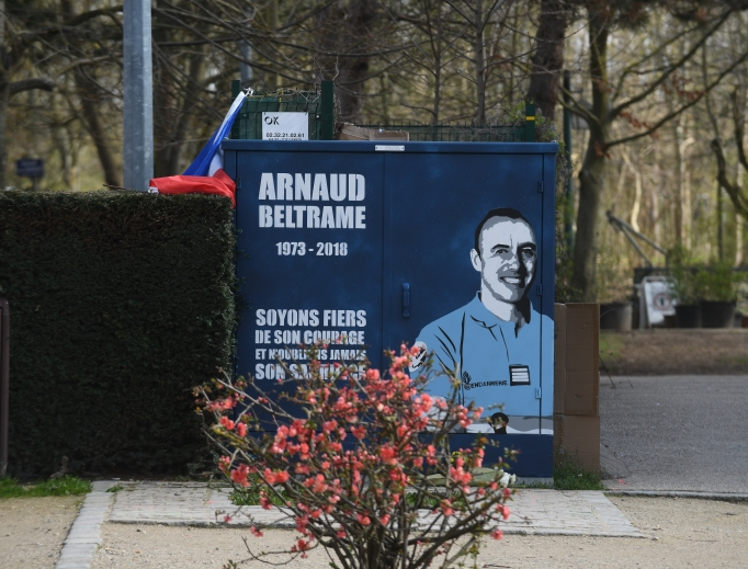 A street art work by artist '7 Nuit' pays tribute to the late Lt. Col. Arnaud Beltrame, as seen March 29 in Port Marly, a suburb of Paris. Beltrame is a heroic officer who was killed after he offered his life in exchange of a hostage in a terrorist attack.