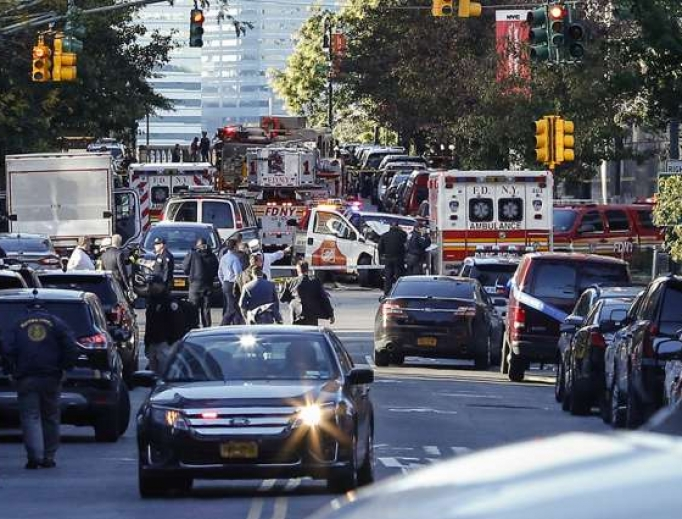 Emergency personal respond after reports of multiple people hit by a truck after it plowed through a bike path in lower Manhattan Oct. 31 in New York City.