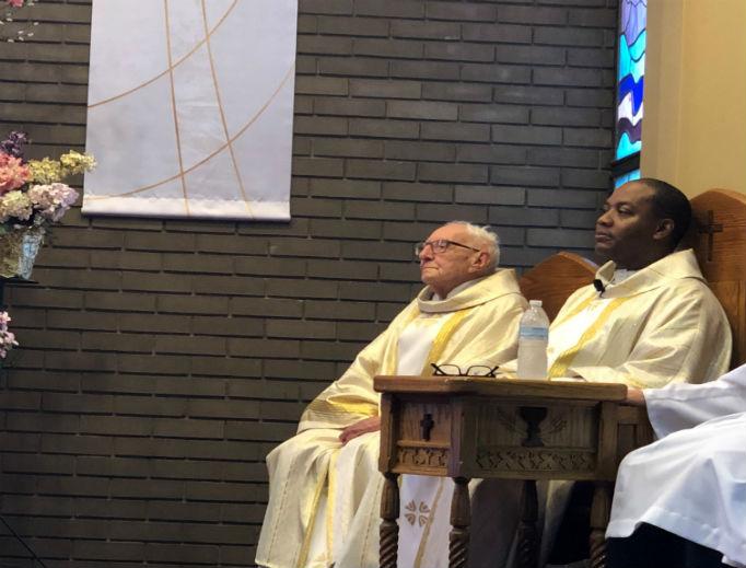 Deacon Larry Girard and Father Luke Iwuji at Saint Sebastian Church.