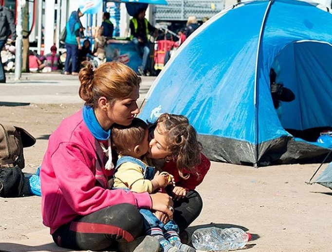 A mother and her children are among the world's millions of refugees.