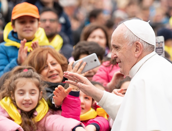 Pope Francis greets pilgrims during his General Audience in St. Peter's Square.