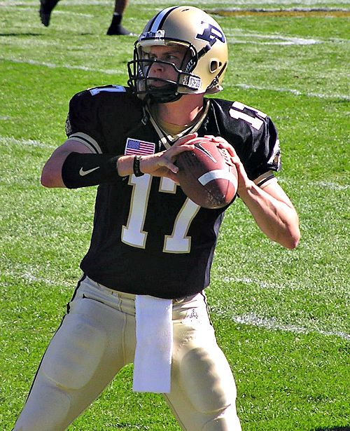 Father Thomas Haan on the gridiron as a Purdue quarterback, above, and below (far right) on the day of his ordination to the priesthood.