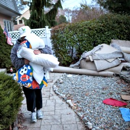 Trisha McAvoy of Brick Township, N.J., evacuates her home due to an approaching storm Nov. 6.