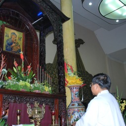 Redemptorist priest at prayer inside Thai Ha Church