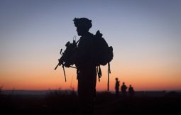 Lance Cpl. James Harris, with the 2nd Battalion 2nd Marines from Camp Lejeune, N.C., is silhouetted at dawn during an operation in the Garmsir district of Helmand Province, Afghanistan, Dec. 23.