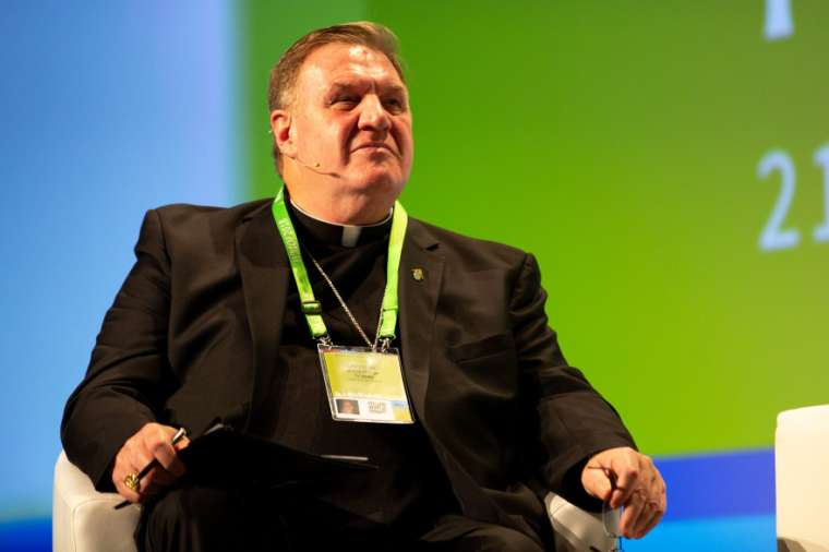 Cardinal Joseph Tobin of Newark moderates a panel at the 2018 World Meeting of Families.