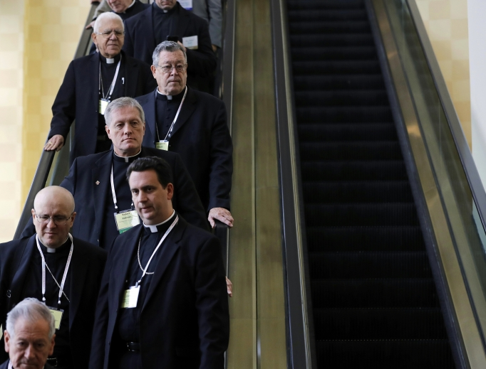 Members of the U.S. Conference of Catholic Bishops ride an escalator during the USCCB's annual fall meeting in Baltimore Nov. 14, 2016. The bishops will meet in Indianapolis this month.