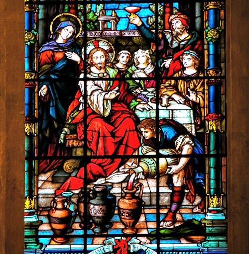 Detail of a stained-glass window from Malaga, Spain, depicting the wedding at Cana.