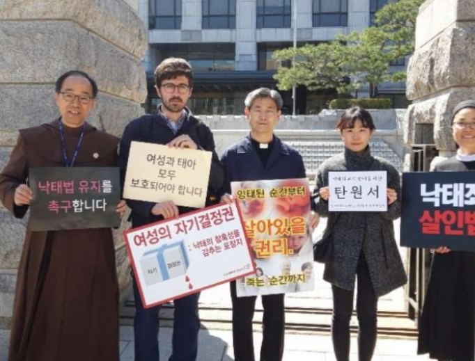 Pro-life activists in South Korea hold signs during the country's March for Life.