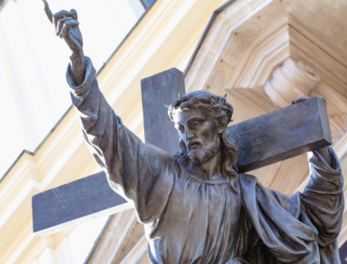 Statue of Jesus Christ in front of the Holy Cross Church in Warsaw.