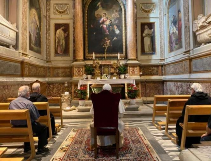 Pope Francis prays in the Basilica of St. Augustine in Campo Marzio, Rome, which contains relics of St. Monica.