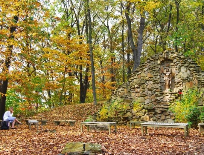 A female student prays at an outdoor grotto at Franciscan University of Steubenville, Ohio. This fall, some students are opting for online classes because of COVID-19 as the university launches five new bachelor degrees that will be completely online.