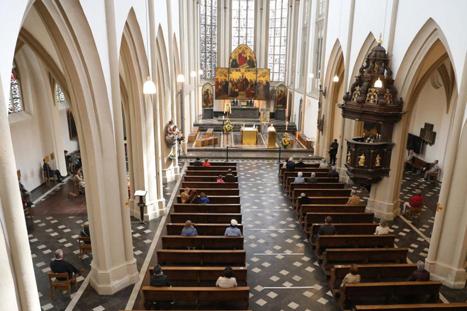 BONN, GERMANY - MAY 03: People arrive for mass at St. Remigius Catholic church for Sunday mass for the first time since March during the novel coronavirus crisis on May 3, 2020 in Bonn, Germany. (Photo by Andreas Rentz/Getty Images)