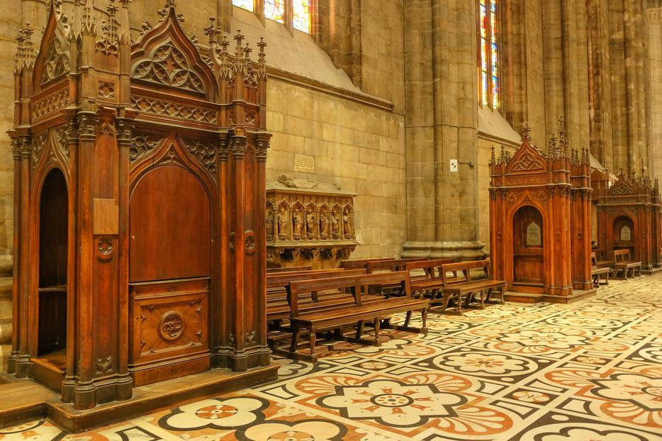 Confessionals inside the Duomo in Milan, Italy.