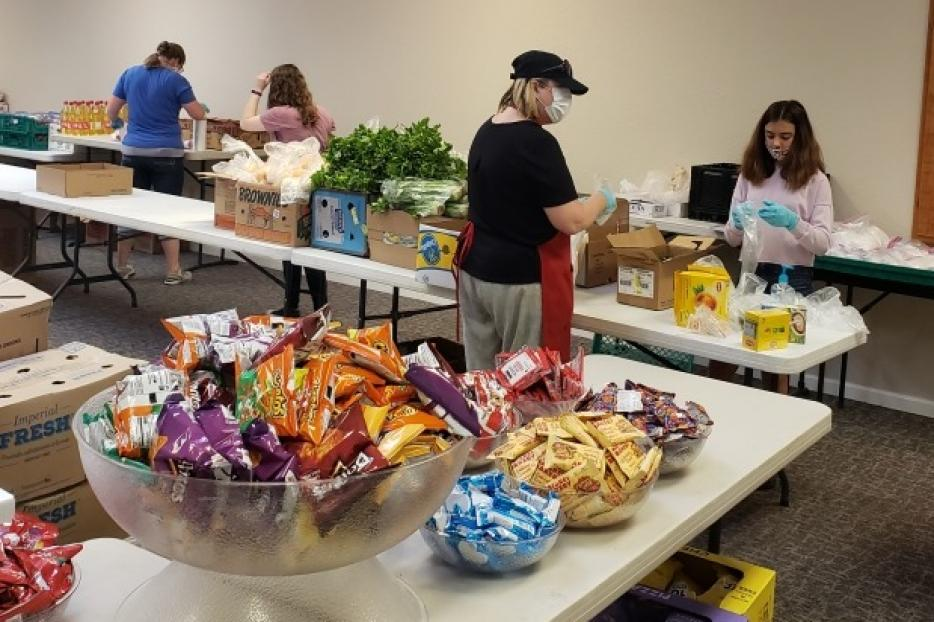 Volunteers and students prepare to open the Agape Food program at Kolbe Academy and Trinity Prep.
