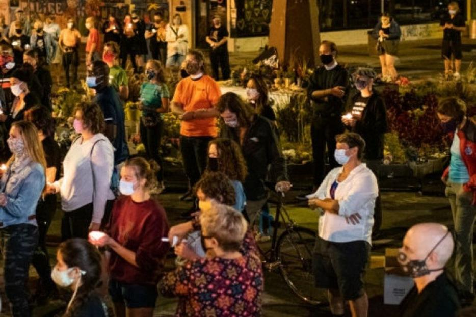 Above, participants take part in a candlelight vigil on Aug. 30 in Minneapolis. The community gathered in the intersection of 38th Street and Chicago Ave. to honor Jacob Blake, 29, who was shot on Aug. 23 by Wisconsin police officers. George Floyd died while in police custody as summer began, on Memorial Day, in Minneapolis.