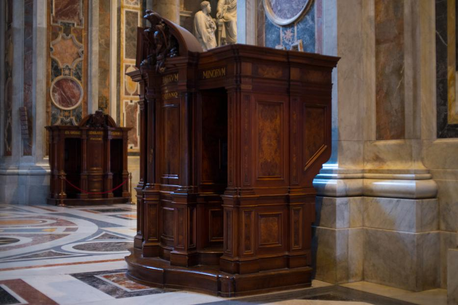 A confession booth is seen in St. Peter's Cathedral in Vatican City. Movies include the sacrament in their plots.