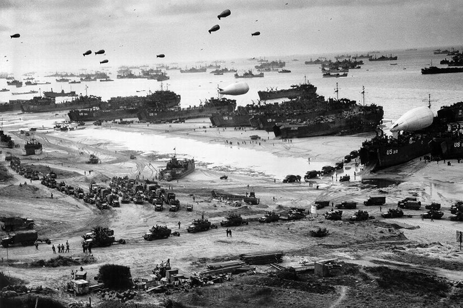 Landing ships putting cargo ashore on Omaha Beach, at low tide during the first days of the operation in June 1944.