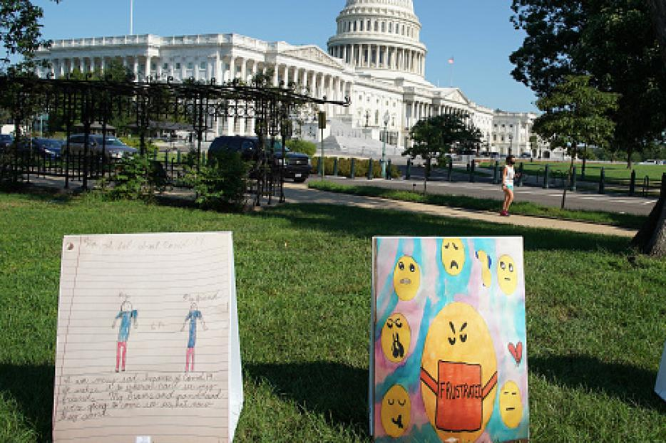 ParentsTogether displays art from children across the country, describing their suffering, anxiety and hopes during the coronavirus pandemic, on Capitol Hill on Aug. 5. Anxiety and mental-health issues are particularly affecting young people, new surveys have found.