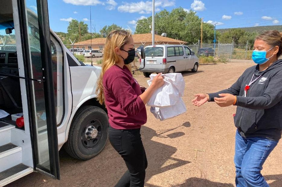St. Michael's Indian School employees have worked to provide food support to Native families traveling to distribution centers.