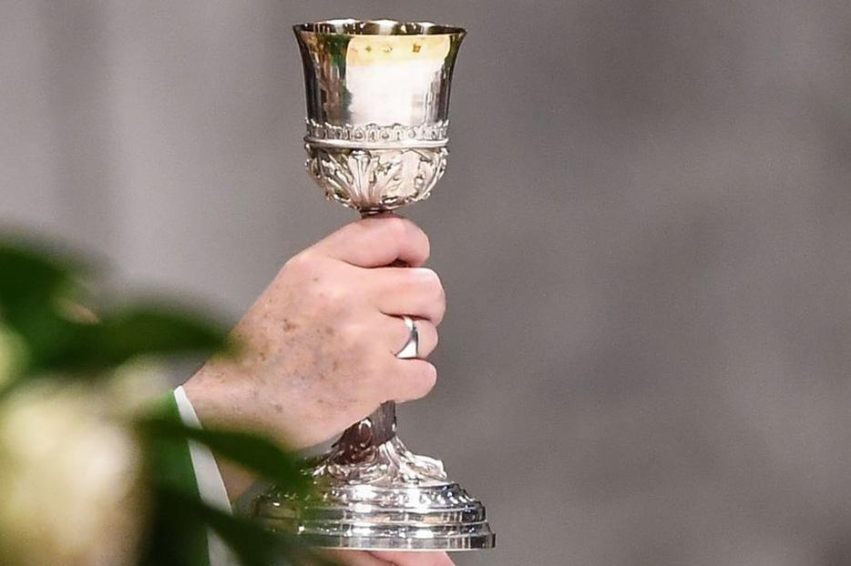 Pope Francis holds the chalice during Mass, Oct. 20, 2019, at St. Peter's Basilica.