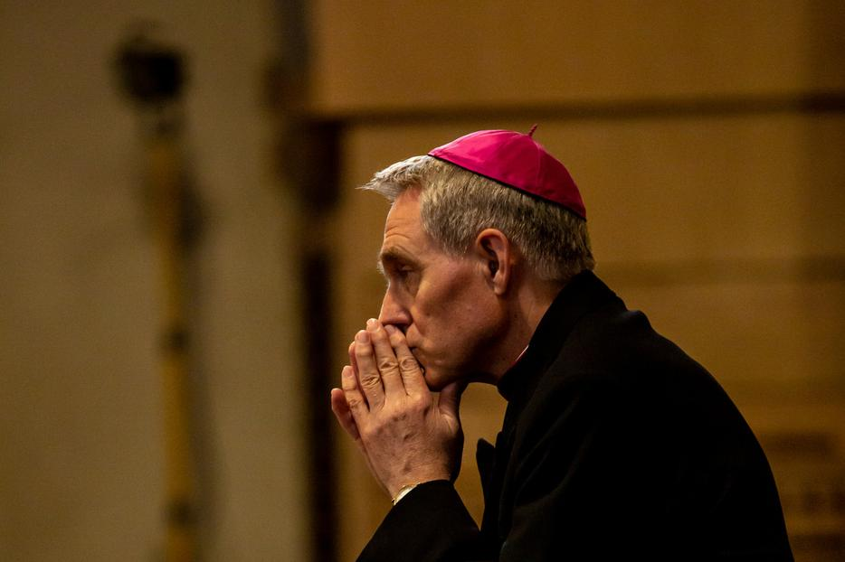 Archbishop Georg Ganswein, prefect of the papal household, prays after a Memorial Mass for the third anniversary of the death of Mother Angelica, Foundress of EWTN, on March 27, 2019.